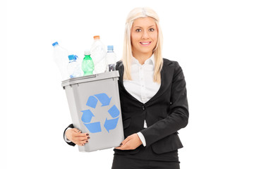 Businesswoman holding a recycle bin