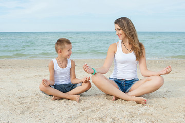 Mother and her son doing yoga