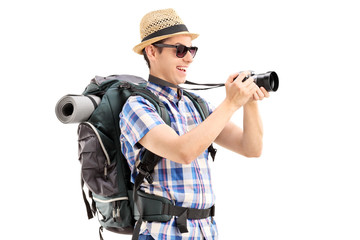 Male tourist taking a picture with a camera