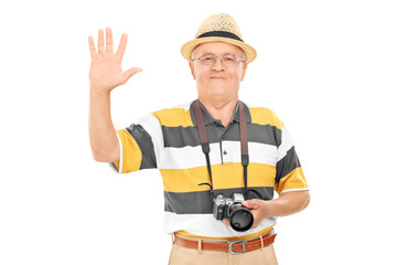 Senior tourist waving with hand