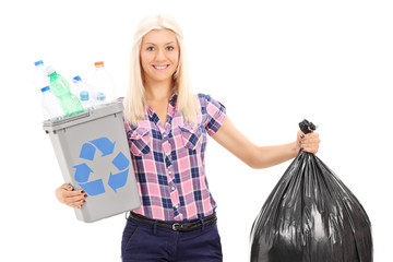 Woman holding a recycle bin and a trash bag