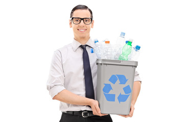 Young man holding a recycle bin full of bottles