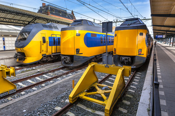 Three modern trains waiting at station