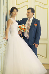 bride and groom portrait in the room