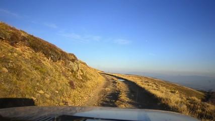 Off-road driving through a mountain plateau
