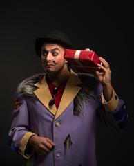 Clown man with Christmas gift box