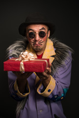 Clown man with Christmas gift box