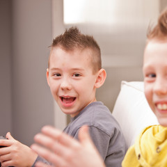 little boy smiling at camera with his friend