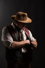 Mature man in costume of traveler old gun