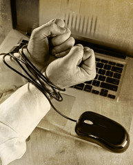 businessman work slave bond with mouse cable to computer laptop
