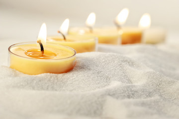Tea light candles in sand