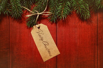 Gift tag on red wood background