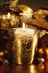 Candles lit with a sparkling gold theme