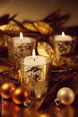 canvas print picture Closeup of candles lit with a sparkling gold theme