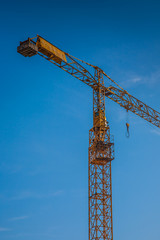 yellow construction crane  on building site