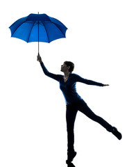 woman holding umbrella wind blowing silhouette