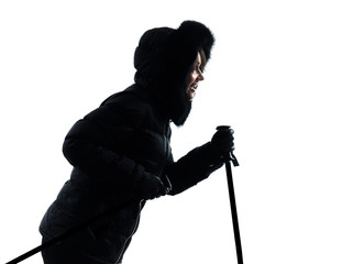 woman winter coat jumping walking silhouette