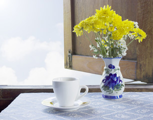 coffee and Flowers in a Vase