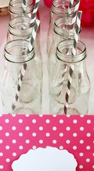 Bottles with grey and white striped straws