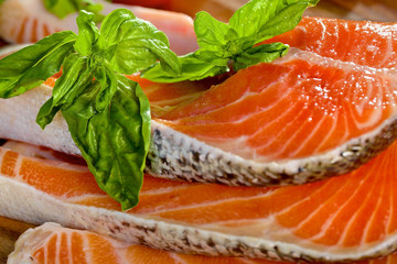 Delicious  portion of fresh salmon fillet with basil