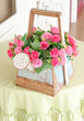 Decorative artificial roses flowers in basket