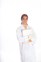 Hispanic Female Wearing Lab Coat While Holding Clipboard
