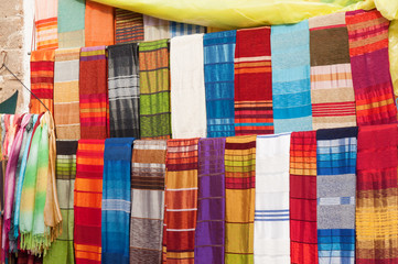 Colorful oriental fabrics in the medina of Essaouira, Morocco