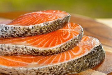 Delicious  portion of fresh salmon fillet on a wooden table