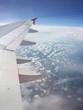 canvas print picture - Tragfläche über den Wolken