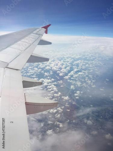canvas print picture Tragfläche über den Wolken