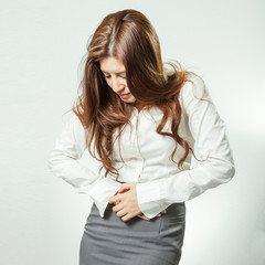 Businesswoman with stomach issues