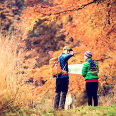 Vintage couple hiking in autumn forest