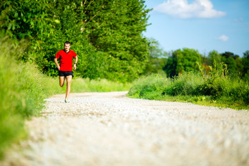 Man running jogging on country road