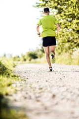 Man jogging in summer on vintage country road