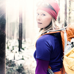 Woman hiking camping vintage winter forest sunlight