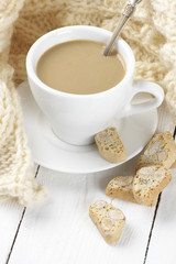 Coffee with cookies and knitwear