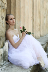 Beautiful ballerina in ancient colonnade