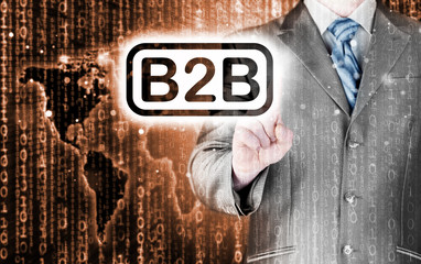 businessman pointing to word B2B, business-to-busines s, written