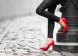 Leinwandbild Motiv Woman wearing red high heel shoes