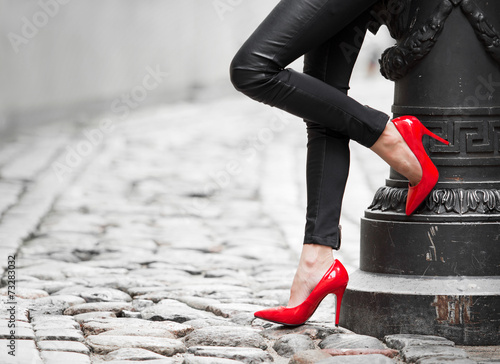 Woman wearing red high heel shoes - 73283032
