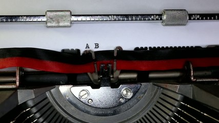 TYPEWRITER with Alphabet in the paper