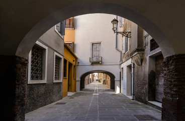 Arched  street in the town of Chioggia, Italy