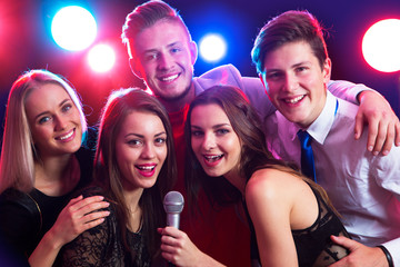 Young people singing at party