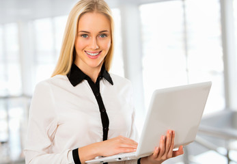 Young business woman using laptop