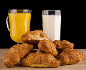 orange juice and milk and croissants