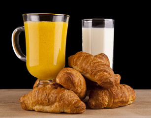 orange juice and milk with croissants