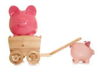 piggy bank being pulled in a cart