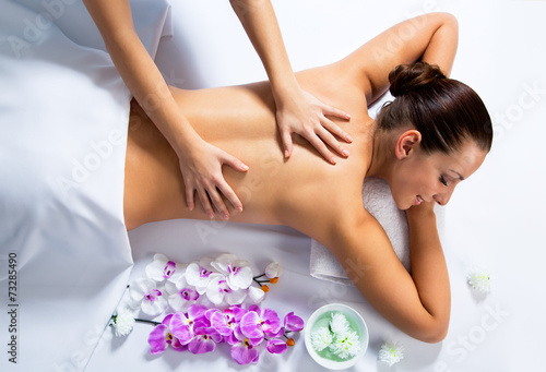 canvas print picture Young beautiful woman in spa environment