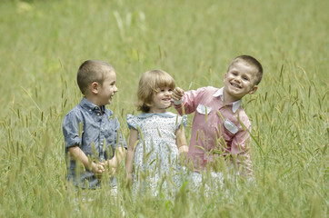 Kids playing in a summer field