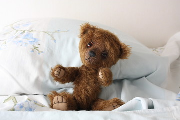 Cute teddy bear in pink pyjama